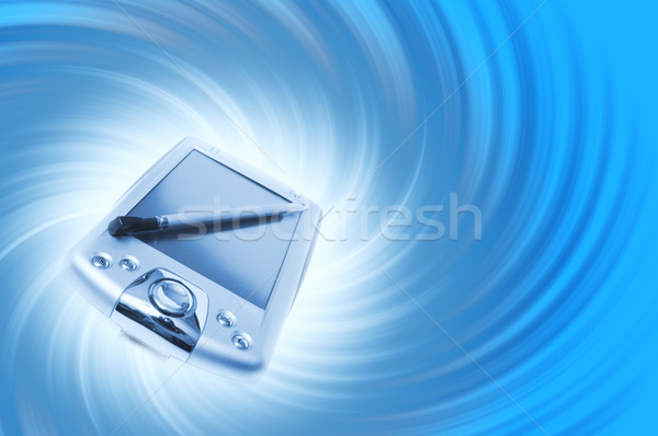 PDA on blue background Stock photo © Nejron