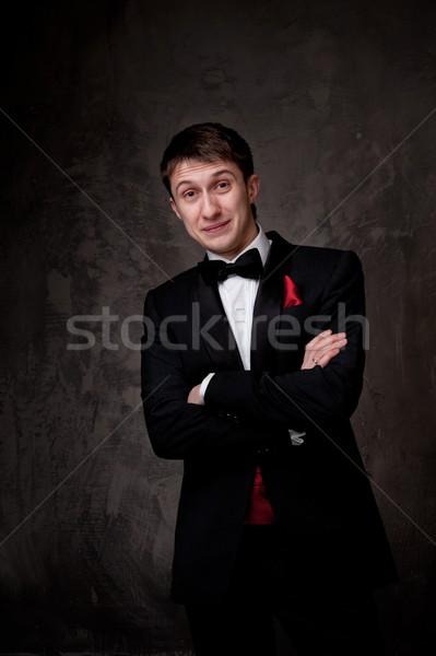 Funny young man wearing tuxedo. Stock photo © Nejron