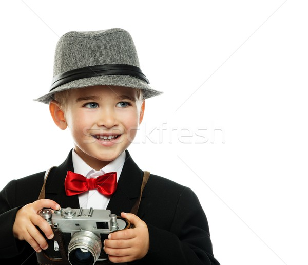 Stock photo: Little boy in hat and black jacket with vintage camera isolated on white background
