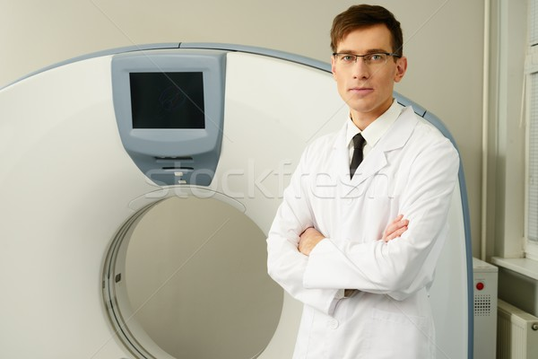 Young doctor standing near computed tomography scanner in a hospital Stock photo © Nejron