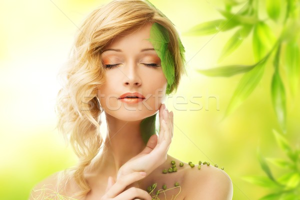 Beautiful young dreaming woman in conceptual spring costume touching her face Stock photo © Nejron