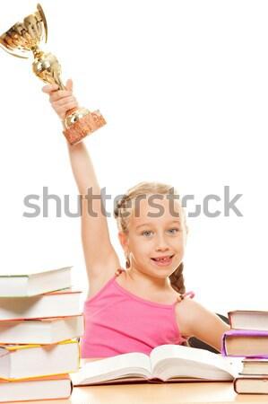 Little schoolgirl sitting between stacks of books Stock photo © Nejron