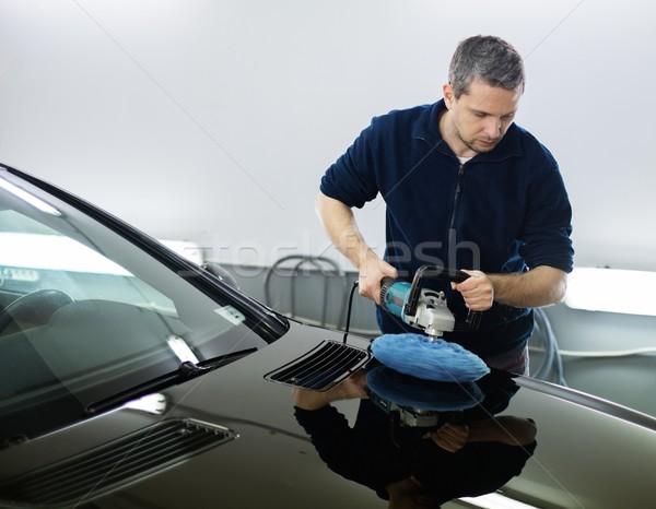 Man on a car wash polishing car with a polish machine  Stock photo © Nejron