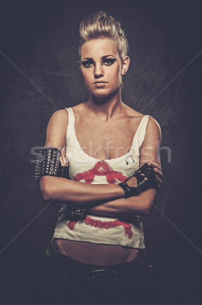Punk girl with spiked bracelets  Stock photo © Nejron