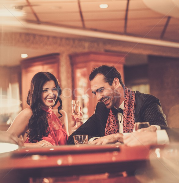Couple behind poker table in a casino Stock photo © Nejron