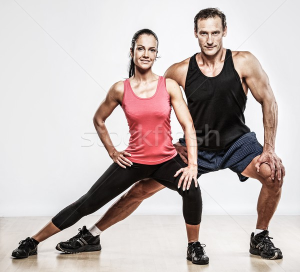 Athletic man and woman doing fitness exercise Stock photo © Nejron