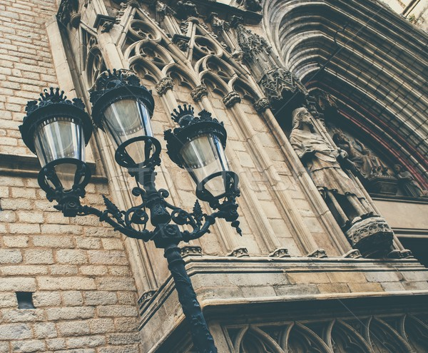Streetlight against cathedral facade with statue Stock photo © Nejron