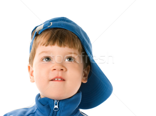 Handsome little boy looking at something. Isolated on white back Stock photo © Nejron