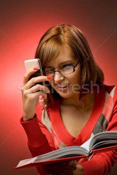 Divertente donna ricerca telefono numero Foto d'archivio © Nejron