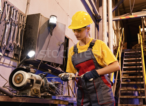 Factory female worker sharpening tools Stock photo © Nejron