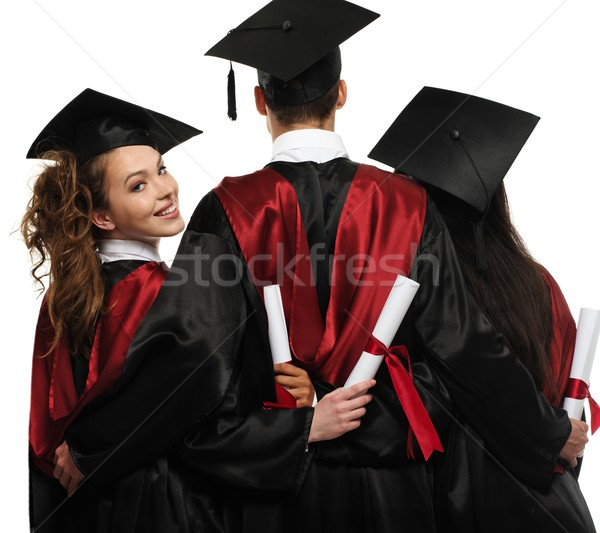 Group of graduated young students with blank notice board Stock photo © Nejron