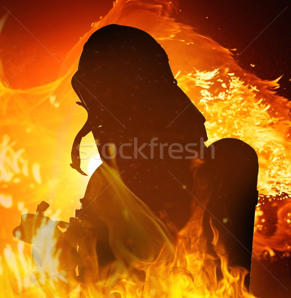Firefighters silhouette in a burning flame  Stock photo © Nejron