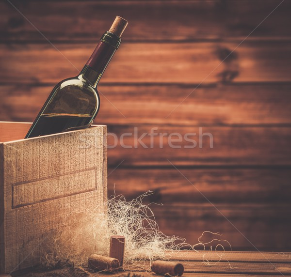 Bottle of wine in box in wooden interior  Stock photo © Nejron