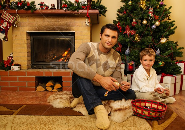 Young father with his son near fireplace in Christmas decorated house interior  Stock photo © Nejron