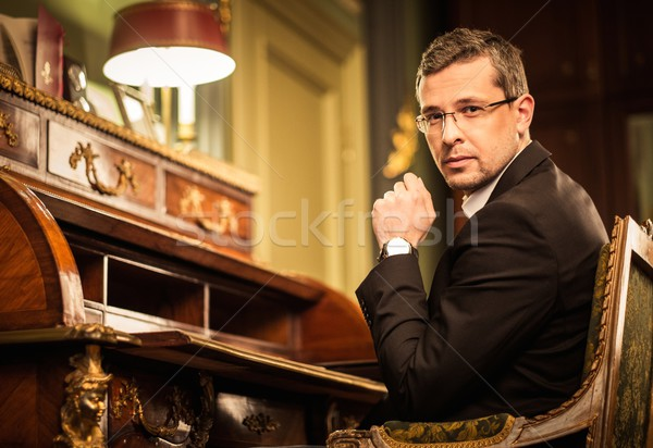 Confident middle-aged man in luxury vintage style interior  Stock photo © Nejron