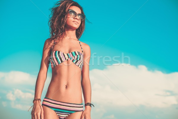 Young black girl in swimming suit against blue sky Stock photo © Nejron