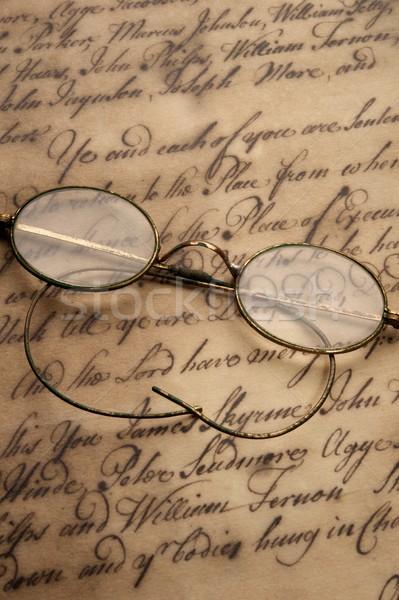 Old glasses on the vintage document Stock photo © Nejron