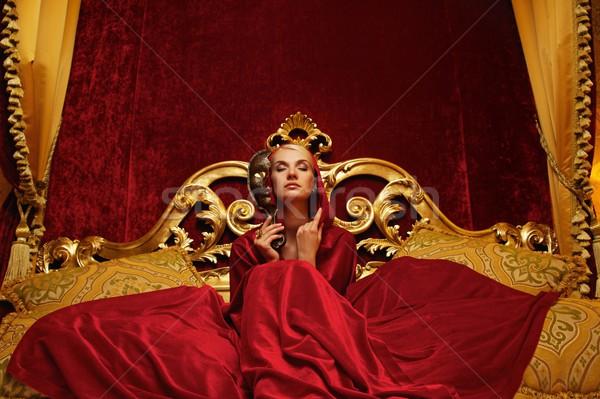 красивая женщина карнавальных маске сидят кровать модель Сток-фото © Nejron