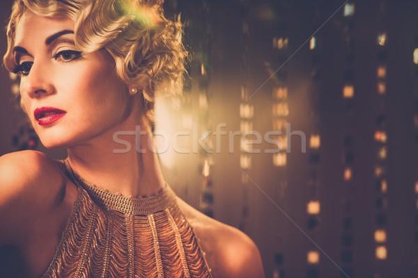Elegante loiro retro mulher dourado vestir Foto stock © Nejron