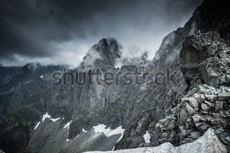 Dark clouds over high mountain peak  Stock photo © Nejron