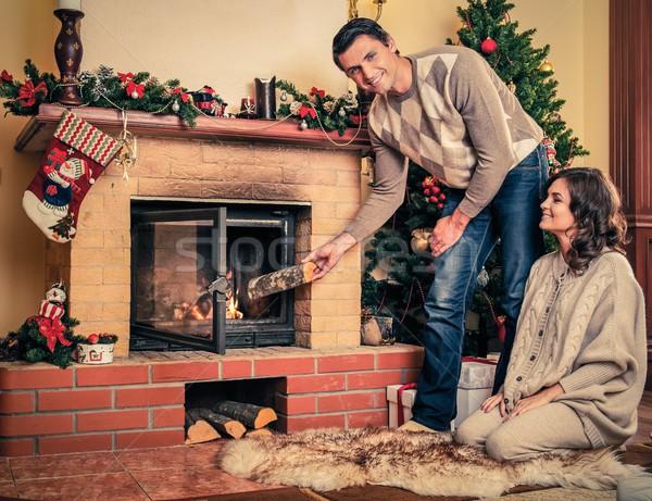 Pár kandalló karácsony díszített házbelső nő Stock fotó © Nejron