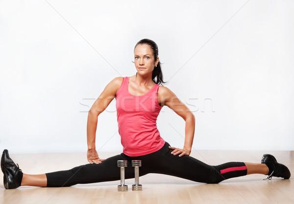 Beautiful athlete woman doing splits.  Stock photo © Nejron