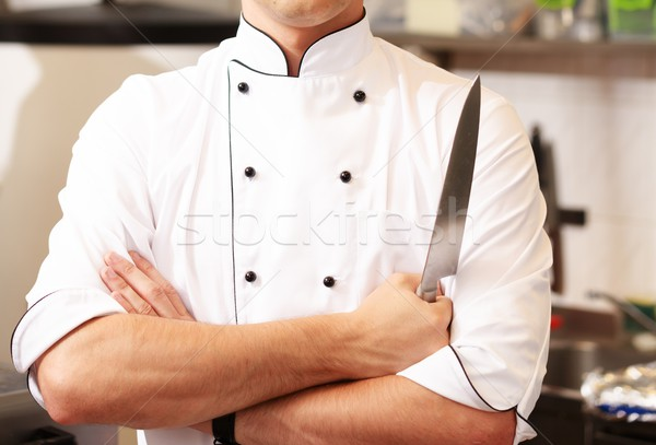 Chief cook in uniform with knife  Stock photo © Nejron
