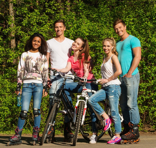 Multi ethnic group of sporty teenage friends in a park  Stock photo © Nejron