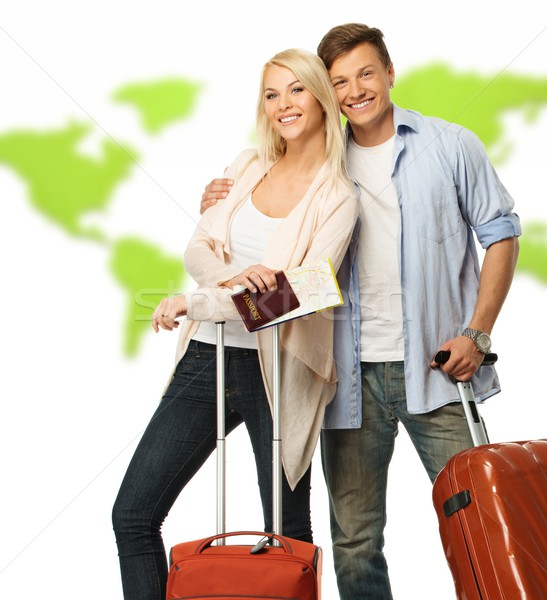 Happy couple with suitcases and documents against world map Stock photo © Nejron