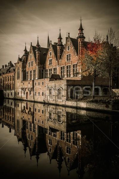 Casas canal Bélgica edificio ciudad puesta de sol Foto stock © Nejron