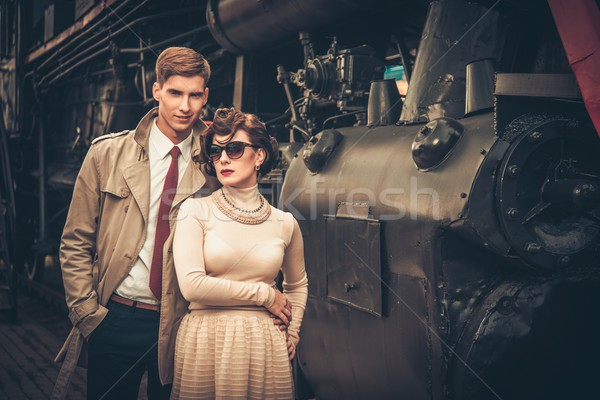 Vintage style couple femme train Photo stock © Nejron