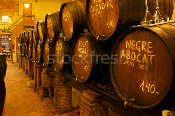 Wine barrels stacked in the old cellar of the winery Stock photo © Nejron