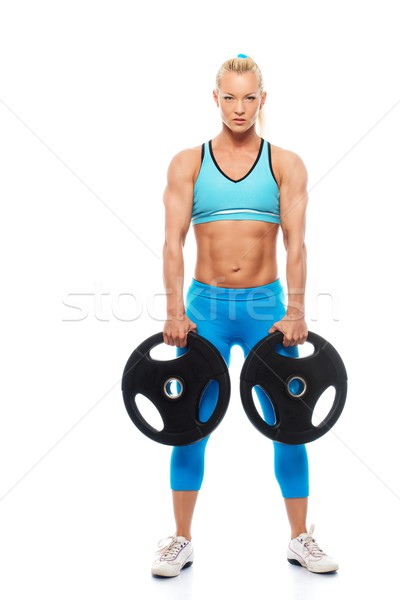 Beautiful bodybuilder girl holding weights isolated on white background  Stock photo © Nejron