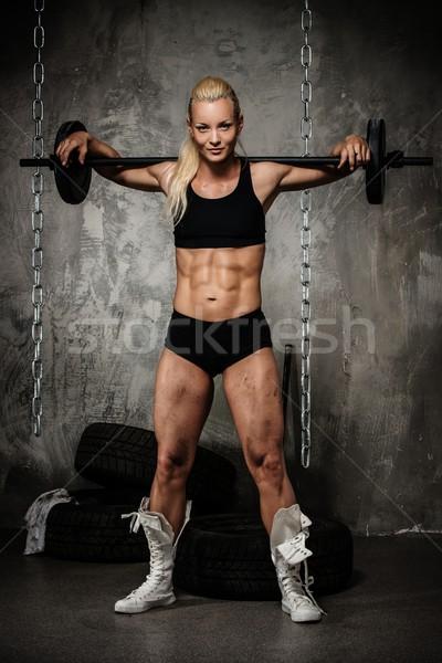 Beautiful muscular bodybuilder holding weights Stock photo © Nejron