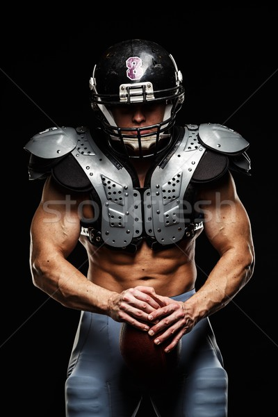 Stock photo: American football player with ball wearing helmet and protective shields