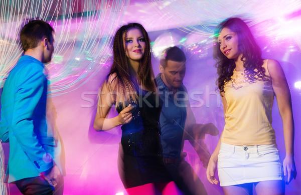 Grupo feliz jóvenes baile club nocturno mujer Foto stock © Nejron