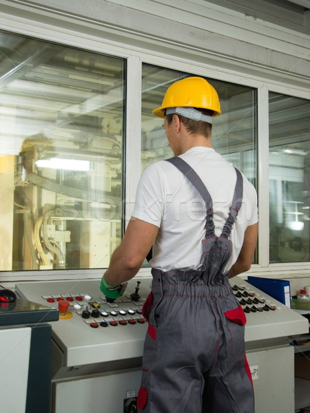 Operator wearing safety hat in a factory control room Stock photo © Nejron