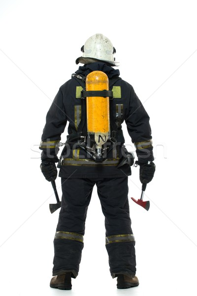 Firefighter with axe and oxygen balloon isolated on white  Stock photo © Nejron