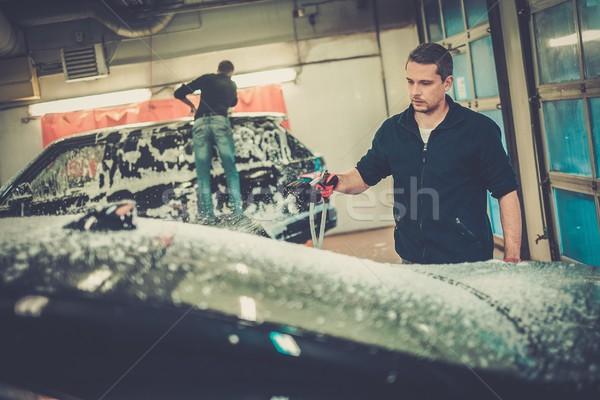 Férfi munkás mosás luxus autó szivacs Stock fotó © Nejron