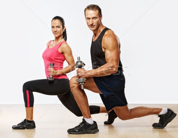 Athletic man and woman with a dumbells. Stock photo © Nejron