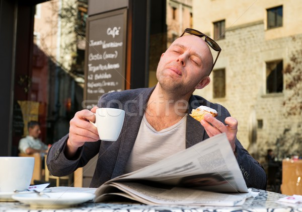MIddle-aged man enjoying coffee with piece of cake in street cafe Stock photo © Nejron