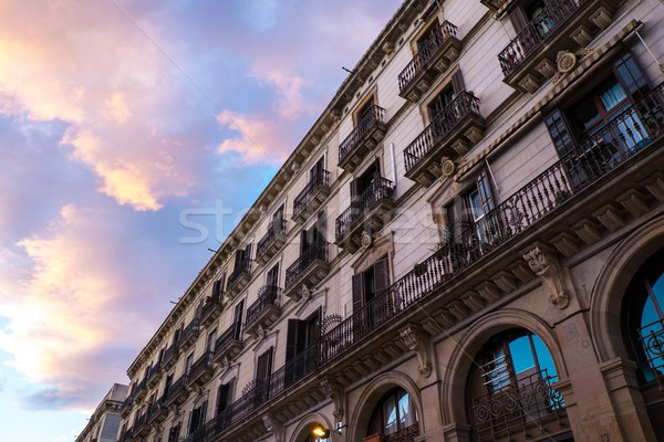 Building facade with  balconies against beautiful sky Stock photo © Nejron