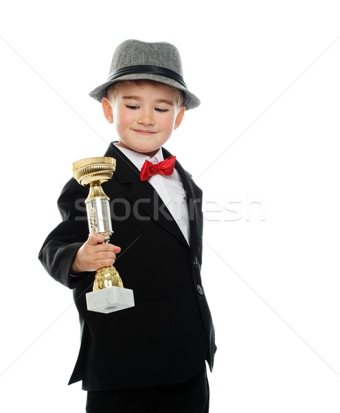 Happy boy in black suit holding prize cup Stock photo © Nejron