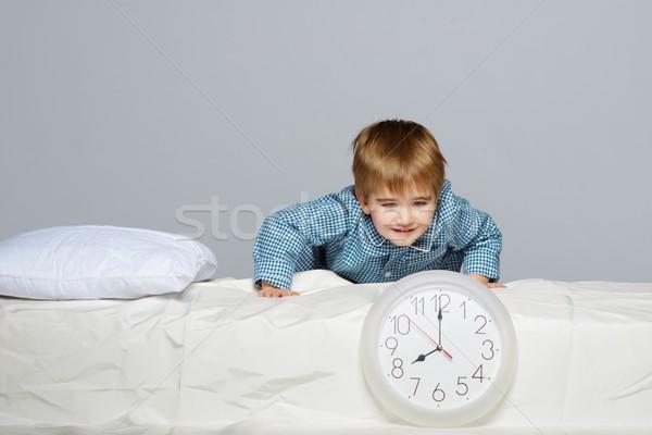 Little boy in blue pyjamas with clock  Stock photo © Nejron