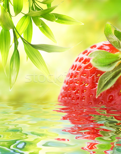 Ripe strawberry reflected in water Stock photo © Nejron