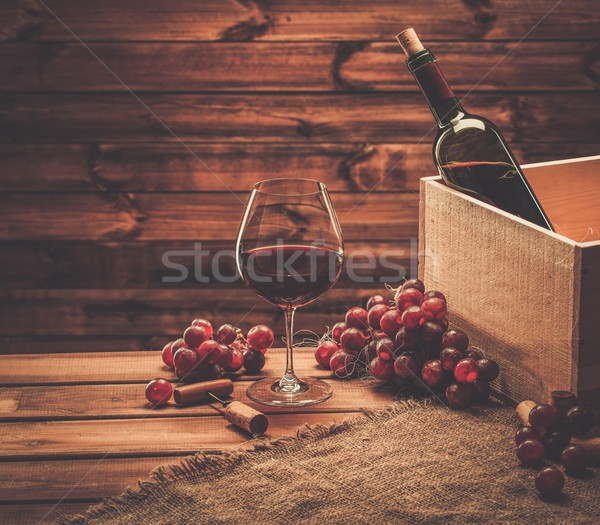 Bottle, glass and red grape on a wooden table  Stock photo © Nejron
