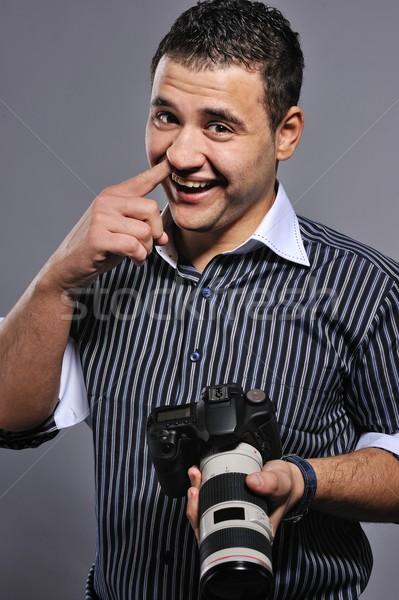 Funny man with a digital camera Stock photo © Nejron