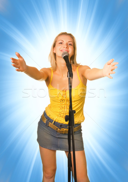Singing young girl on abstract blue background Stock photo © Nejron