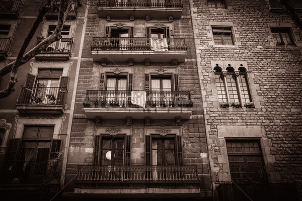 Toned picture of building facade with balconies Stock photo © Nejron