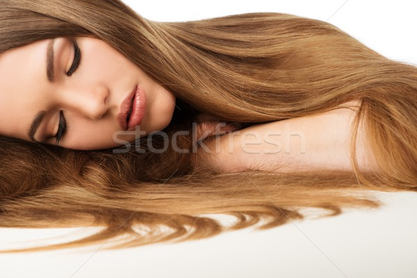 Beautiful young girl with long hair isolated on white  Stock photo © Nejron
